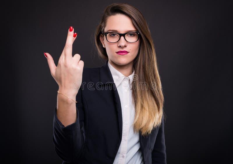 Ernstige vrouwelijke manager die pech wensen royalty-vrije stock foto's