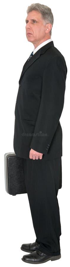 Ernstige Zakenman Standing, Geïsoleerde Lookoing, stock afbeelding
