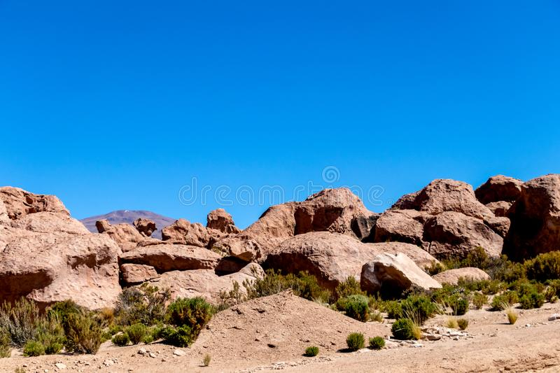 Rocks Valley in the Altiplano of Bolivia, South America. Eroded and bizarre formed orange colored rocks and boulders in Bolivian Valley of the Rocks (Valle royalty free stock photo