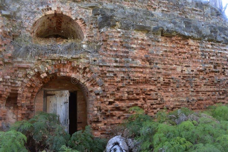Eroded brick wall stock image