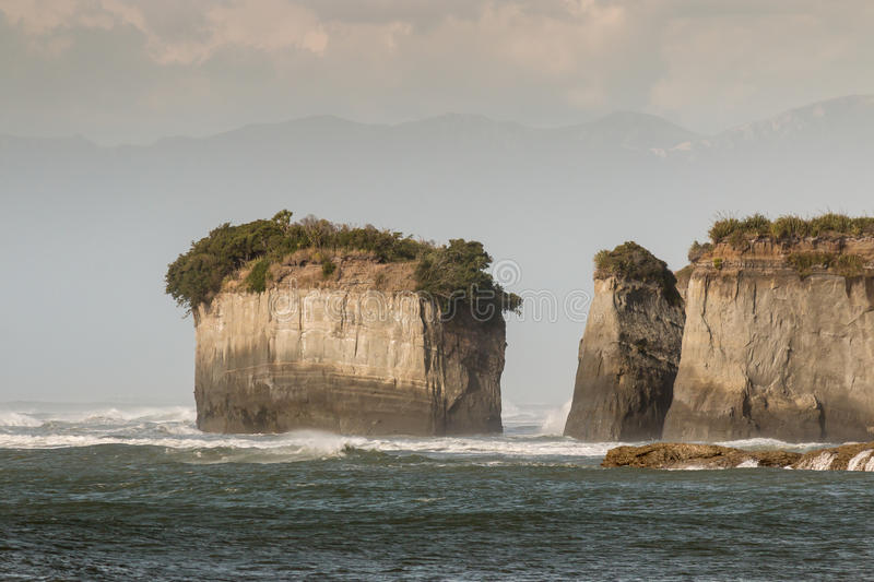 Eroded cliffs at Cape Foulwind on West Coast. Of New Zealand stock photo