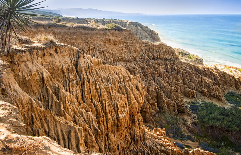 Eroded Cliffs, Ocean, San Diego, California. The eroded cliffs of Torrey Pines State Natural Reserve, on the Pacific Ocean, with La Jolla barely seen in the royalty free stock photography