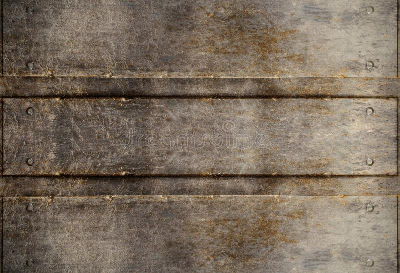 Eroded metal plates with rivets royalty free stock photo