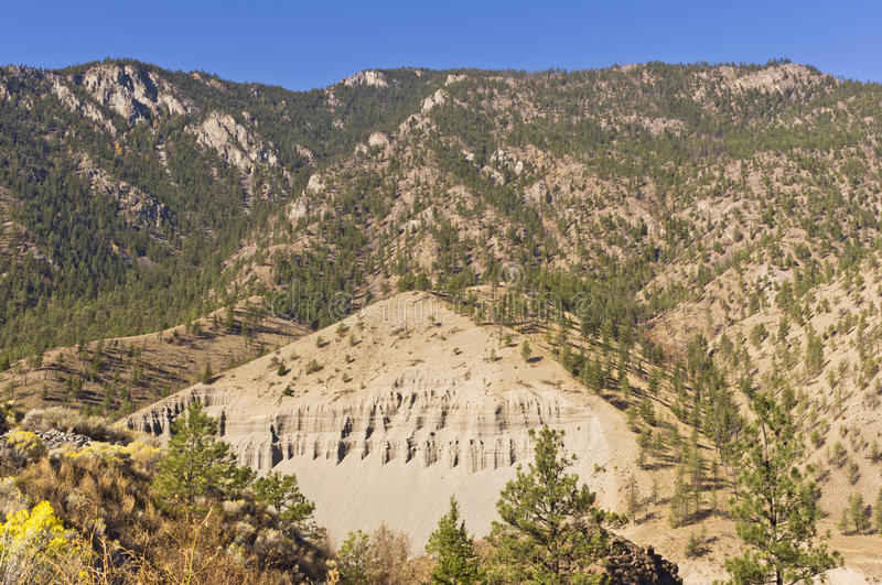 Eroded mountainside and talus slope. An eroded mountainside and talus slope in the Thompson river valley near Spences Bridge in the interior of BC, Canada royalty free stock photos
