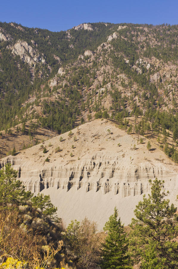 Eroded mountainside on the Thompson River. An eroded mountainside and talus slope in the Thompson river valley in the interior of BC, Canada near Spences Bridge stock images