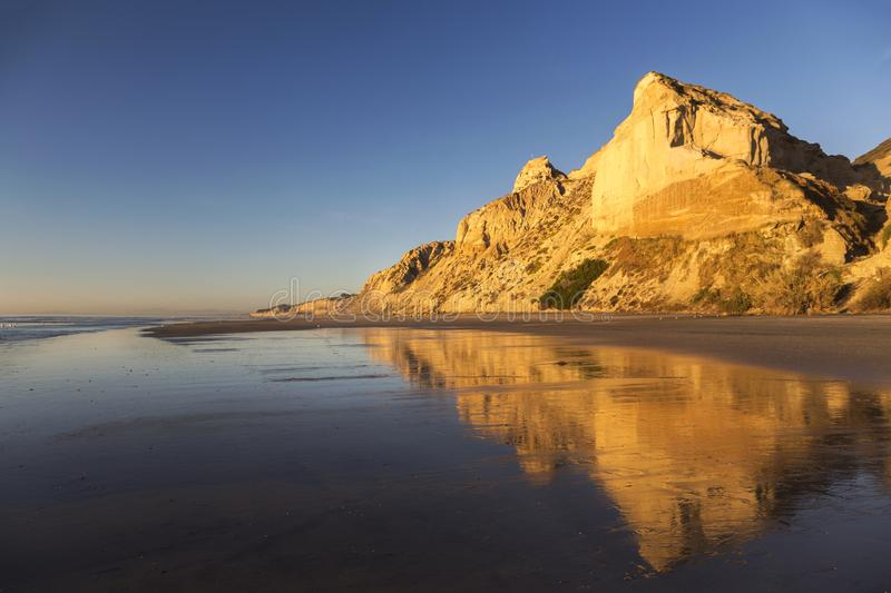 Eroded Sandstone Cliffs Reflected on Torrey Pines State Beach La Jolla San Diego California. Eroded Sandstone California Cliffs and Torrey Pines State Beach stock image