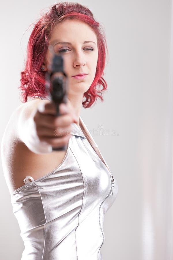 Eroina d'annata dello spazio eccellente con una pistola fotografia stock libera da diritti