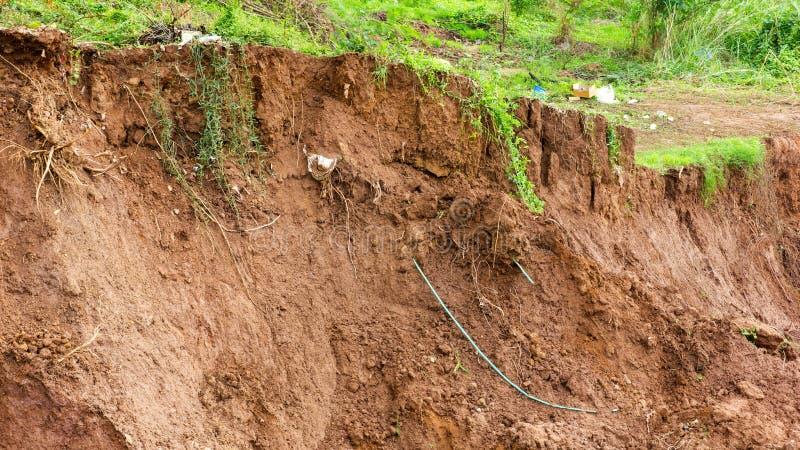 Erosão litoral, corrediças da terra imagens de stock royalty free