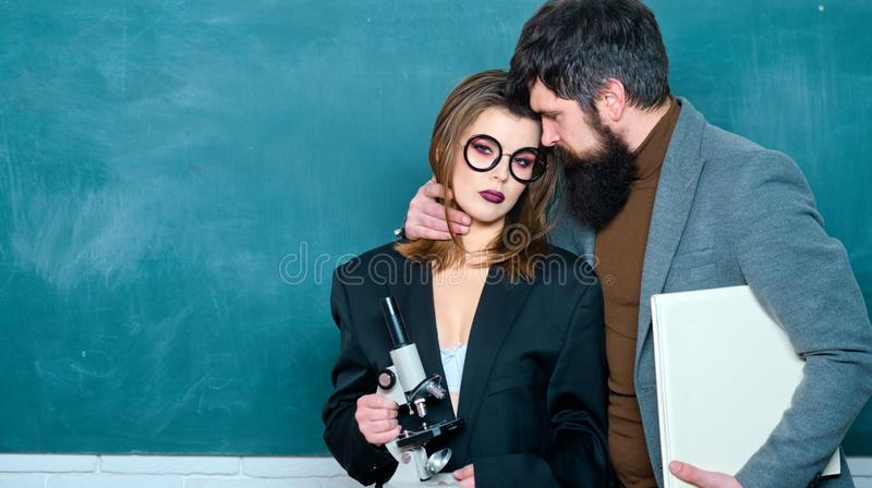 Erotic game. Students build positive relationships with their teachers. Romance. Students during break in the cafe royalty free stock photography
