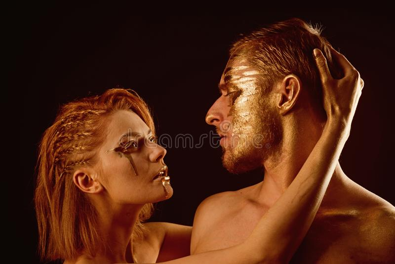 Erotic games of couple in love. couple with golden body art makeup isolated on black. Golden collagen mask and. Beauty. 24K Gold. Gold spa and skincare royalty free stock photos