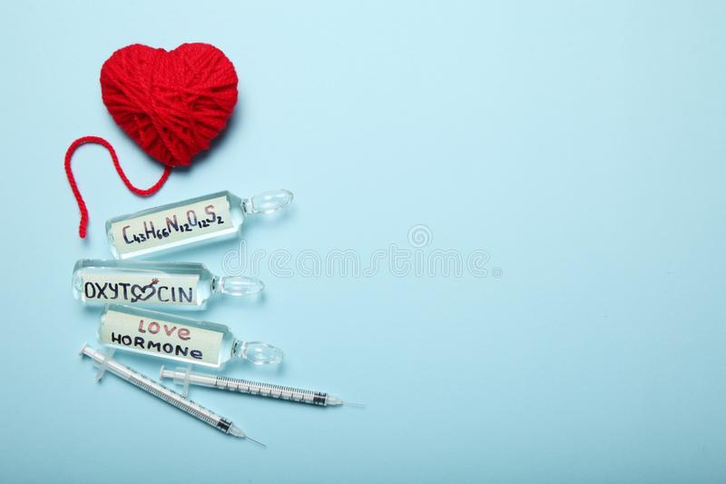 Erotic oxytocin hormone in ampoules. Love and pregnancy. Copy space for text.  royalty free stock image