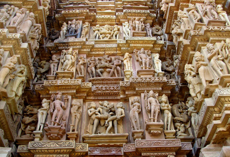 Erotic sculptures in Khajuraho Temple Group of Monuments in India. Erotic sculptures, ornament and decorations on the walls of Khajuraho Temple Group of royalty free stock images