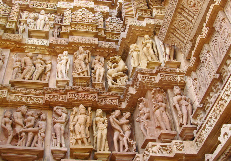 Erotic sculptures in Khajuraho Temple Group of Monuments in India. Erotic sculptures, ornament and decorations on the walls of Khajuraho Temple Group of stock image