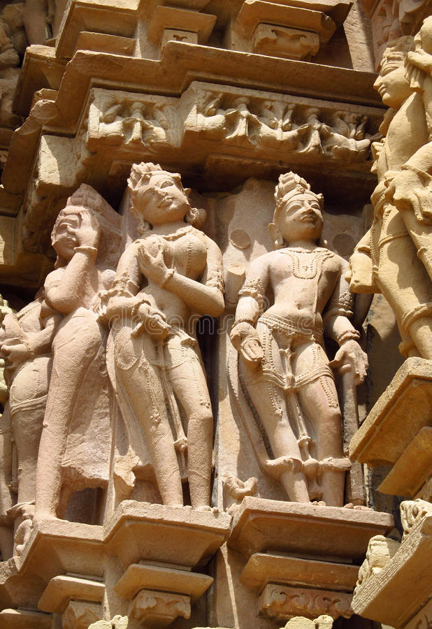 Erotic sculptures in Khajuraho Temple Group of Monuments in India. Erotic sculptures, ornament and decorations on the walls of Khajuraho Temple Group of royalty free stock photography