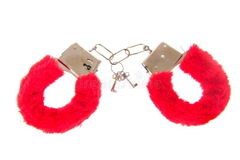 Erotische rote Handfesseln lizenzfreie stockfotos