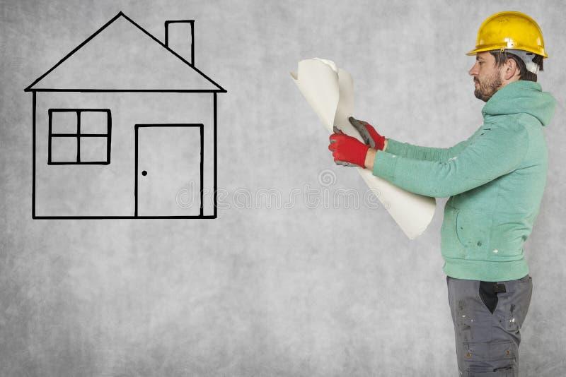 Errichten eines neuen Hauses, Baupläne stockfotografie