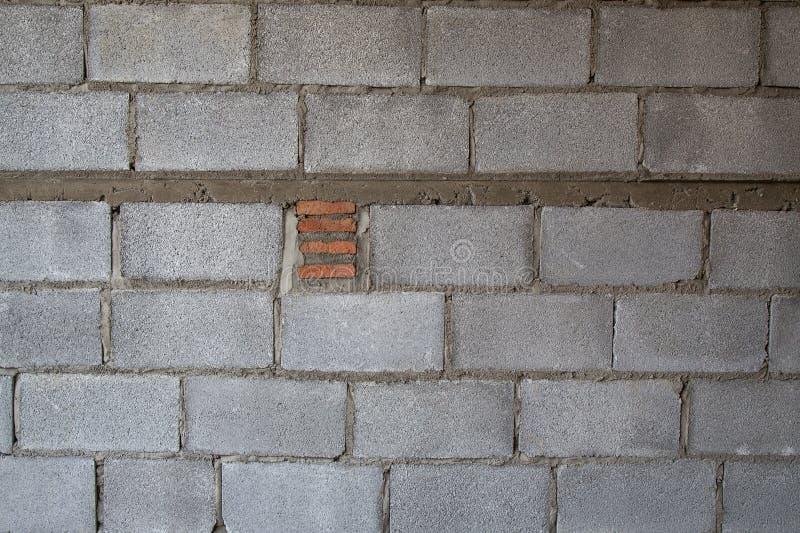 Errichtende hohle Backsteinmauerbild-Nahaufnahmebeschaffenheit lizenzfreie stockbilder