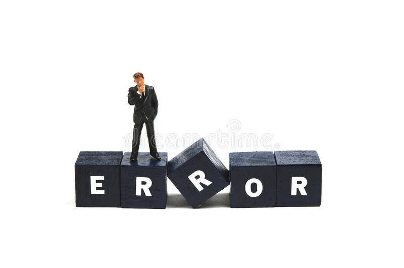 Error. A manager standing on the word error royalty free stock image