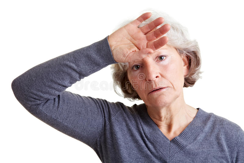 Erschöpfte ältere Frau stockfotografie