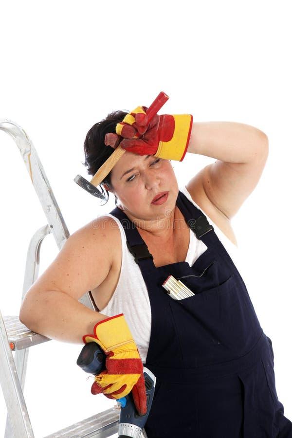 Erschöpfte DIY Hausfrau oder Handwerker stockfoto