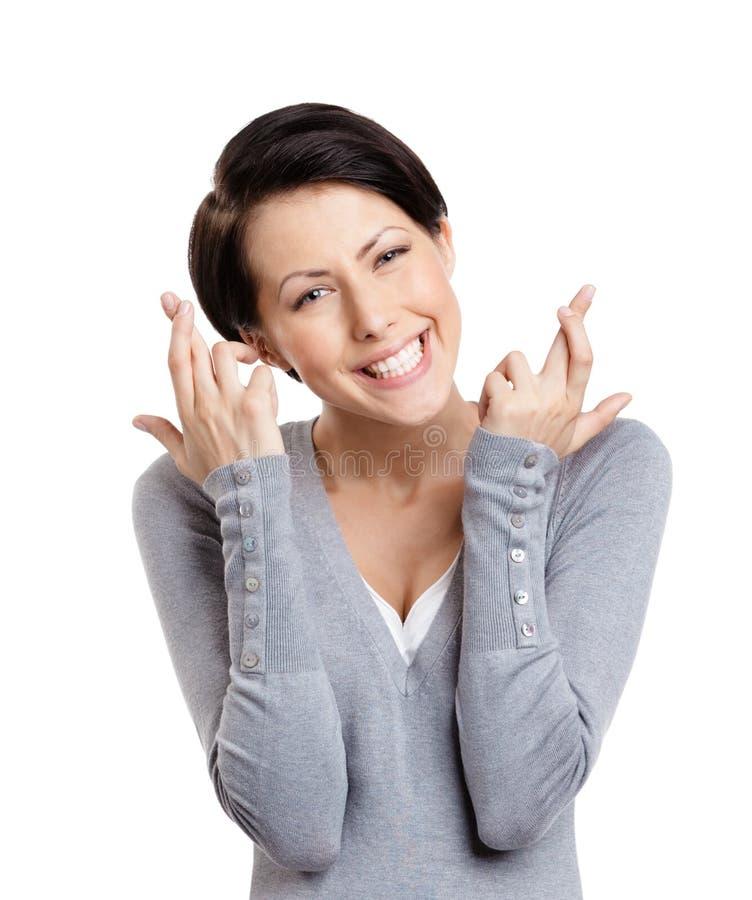 Erscheinen der jungen Frau kreuzten Finger lizenzfreie stockfotos
