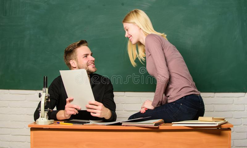 Ertificate proves successfully passed university entrance exam. Students in classroom chalkboard background. Education. Concept. College entrance exam. Prepare stock photography
