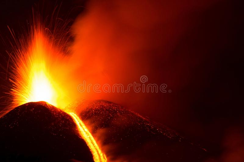 Eruption at the active crater of the Etna volcano with lava explosion royalty free stock photography