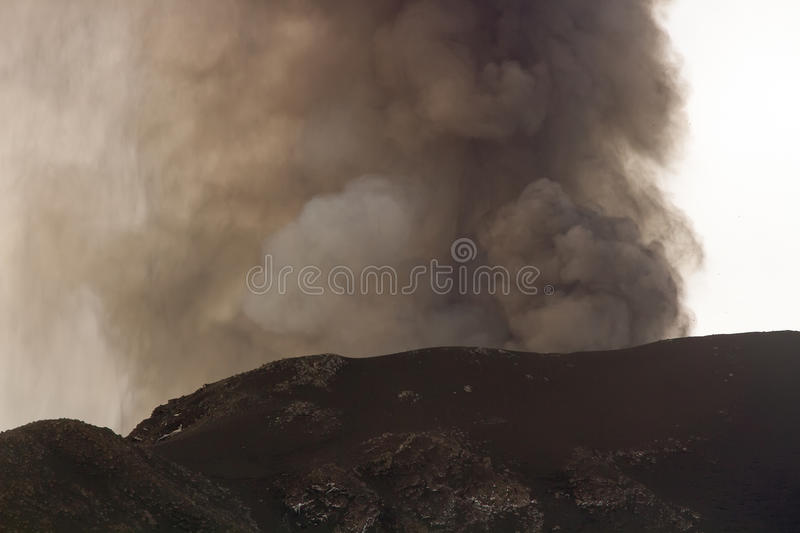 Eruption of Mount Etna. Explosion with ash emission and lava flow royalty free stock image