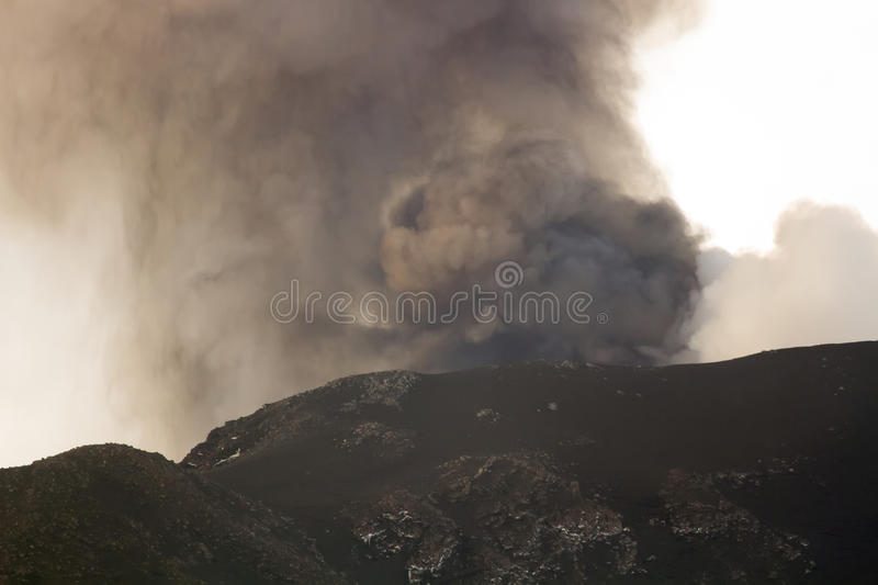 Eruption of Mount Etna. Explosion with ash emission and lava flow royalty free stock images