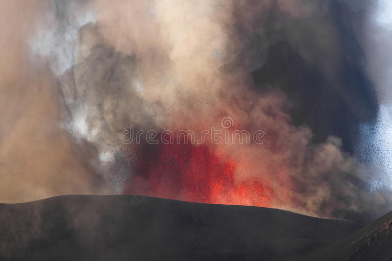 Eruption of Mount Etna. Explosion with ash emission and lava flow royalty free stock photography