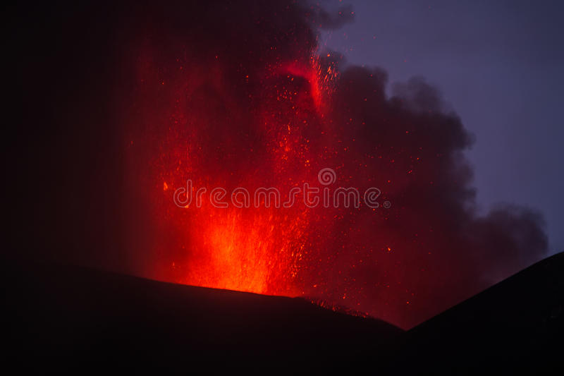Eruption of Mount Etna. Explosion with ash emission and lava flow royalty free stock photo