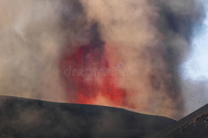 Eruption of Mount Etna. Explosion with ash emission and lava flow stock photography