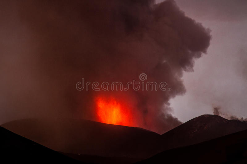Eruption of Mount Etna. Explosion with ash emission and lava flow stock photo