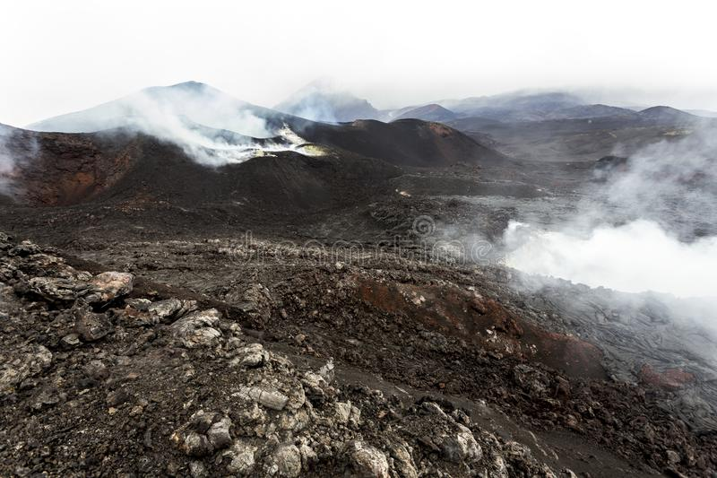Eruption of Volcano Tolbachik. Crater and solid lava fields, Kamchatka Peninsula, Russia. Mountain landscape stock photos