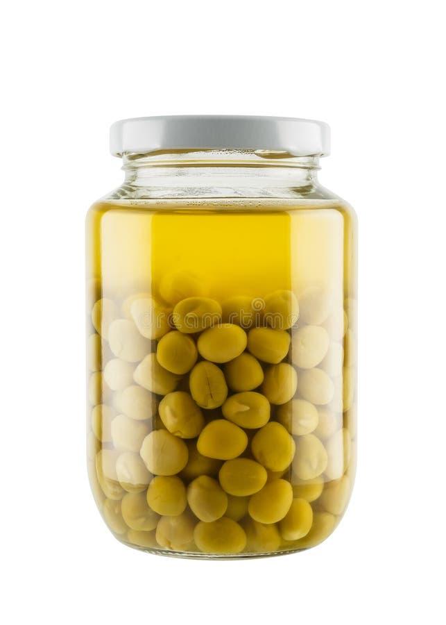 Ervilhas preservadas no frasco de vidro fotografia de stock royalty free