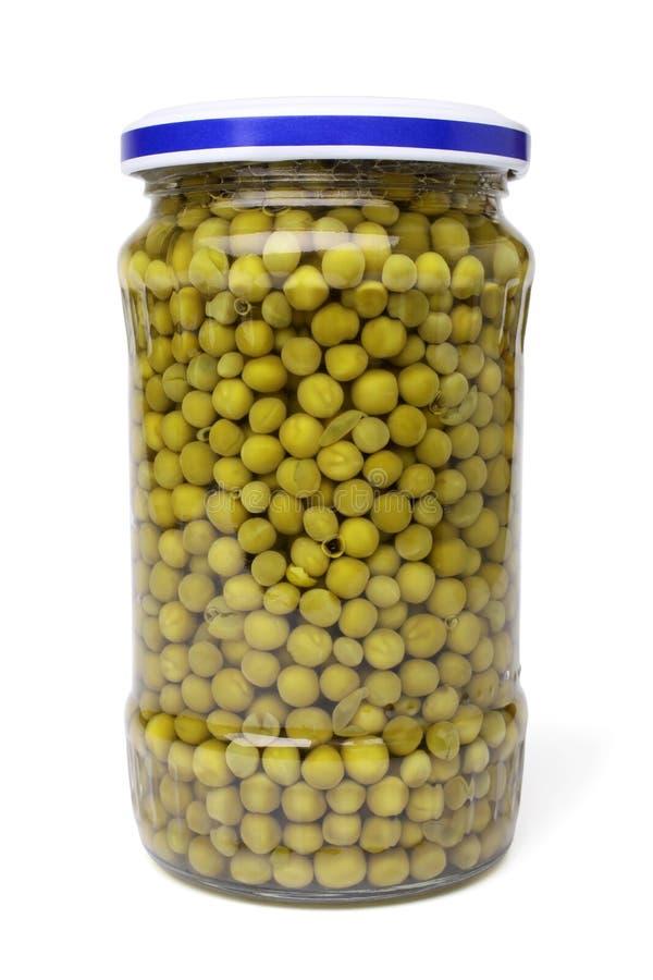 Ervilhas preservadas no frasco de vidro imagens de stock royalty free