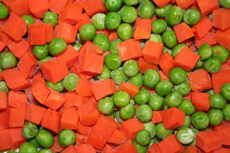 Ervilhas verdes da cenoura foto de stock royalty free