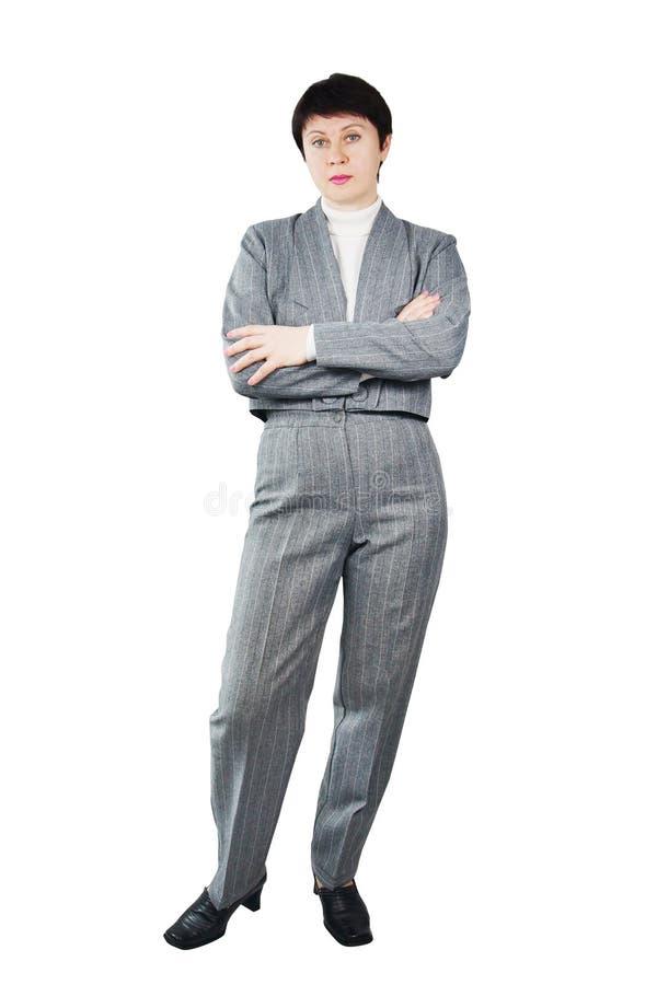 Erwachsene Frau gekleidet in der grauen Klage lizenzfreies stockbild