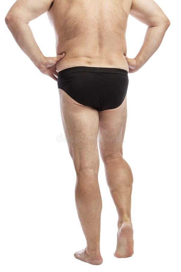Erwachsener dicker Mann in den schwarzen kurzen Hosen, hintere Ansicht in voller Länge Getrennt auf einem wei?en Hintergrund stockfotos