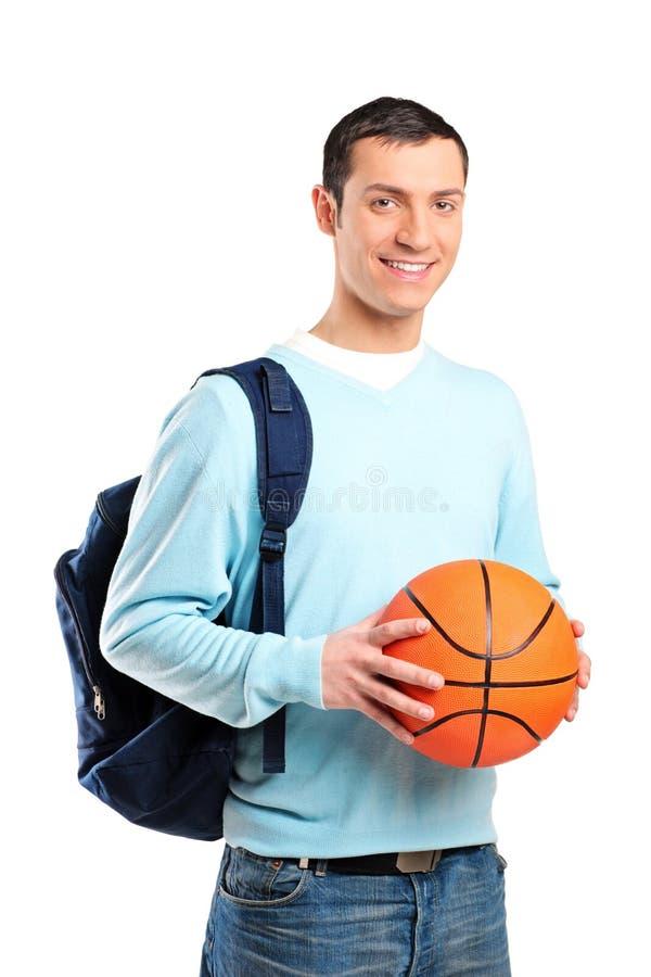 Erwachsener mit dem Beutel, der einen Basketball anhält stockbilder