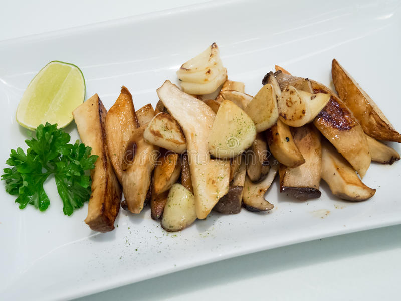 Eryngii Mushrooms With Butter Stock Photography