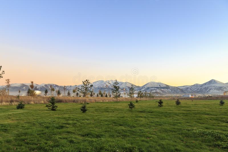 Erzurum from green fields with Palandoken mountain background stock photo