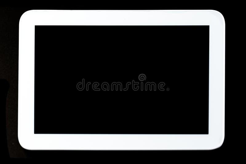 PC de la tableta en fondo negro imagen de archivo libre de regalías