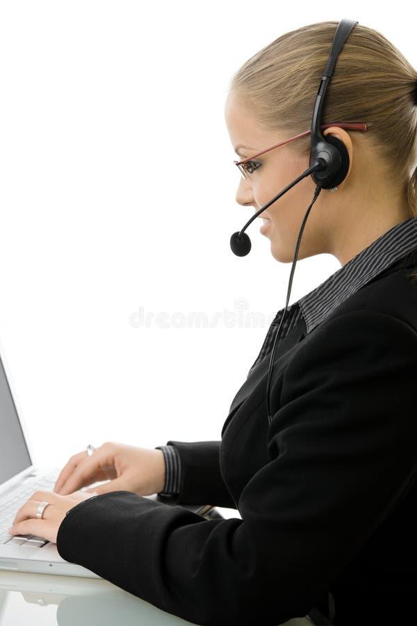 Es-unterstützen Sie Bediener im Kopfhörer stockfoto