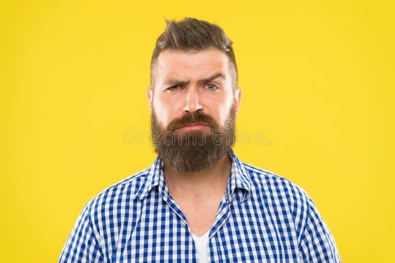 Es usted serio Cara seria del hombre que aumenta la ceja no confiada Tenga algunas dudas Cara barbuda del inconformista no segura imagen de archivo