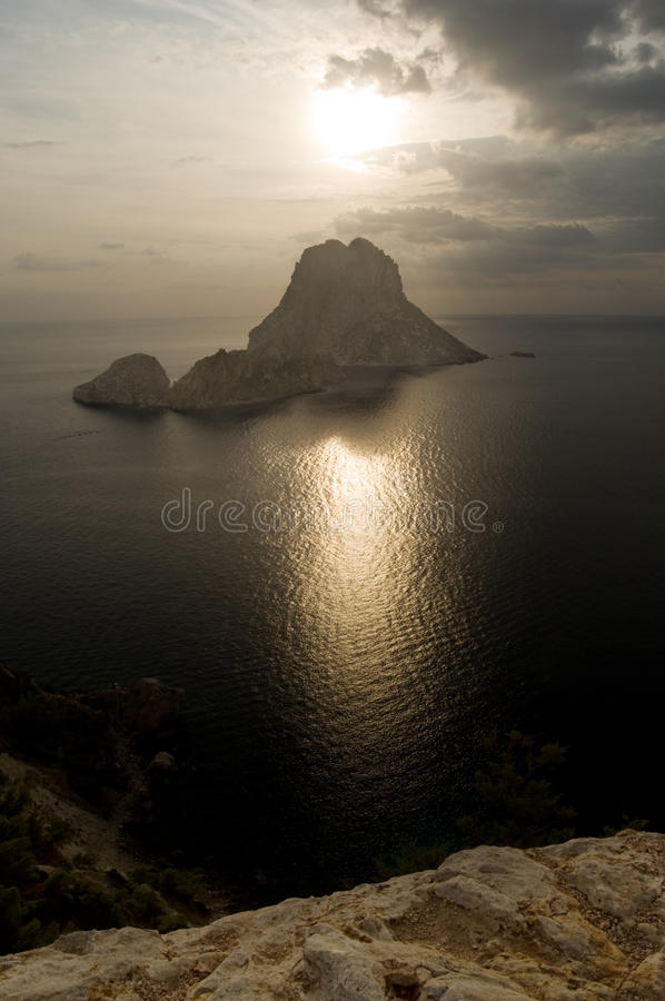 Download Es Vedra Island In Front Of The Setting Sun Stock Image - Image of holiday, rocky: 21683409