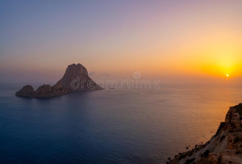 Es Vedra islet sunset in Balearic Islands. Es Vedra islet sunset in Sant Josep of Balearic Islands stock photography