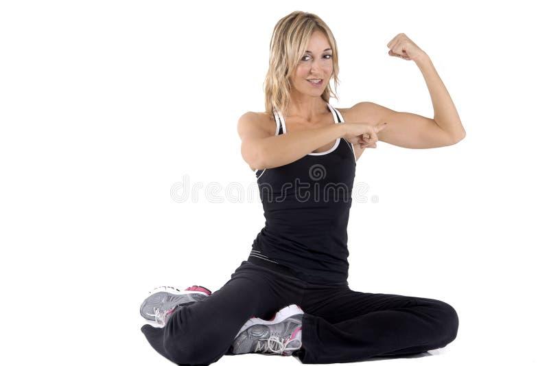 Esamini i miei muscoli immagini stock