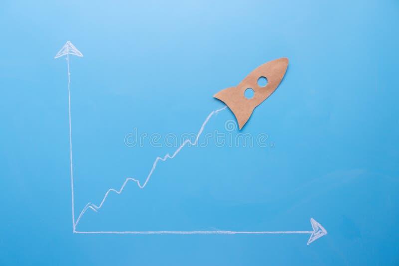 esboço do gráfico e um foguete de papel nele ilustração do vetor
