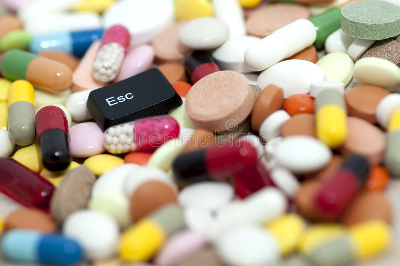 Esc key among drugs (escape from drugs) stock images